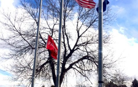 The US flag at half mast outside the school.