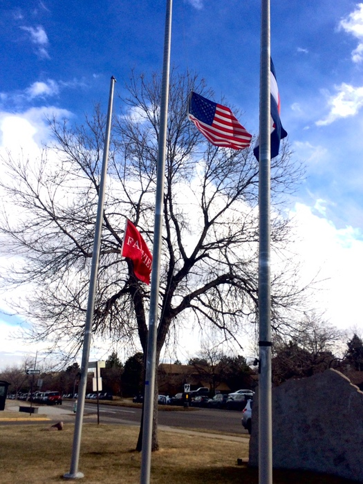 The+US+flag+at+half+mast+outside+the+school.