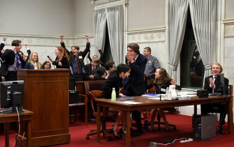 The Mock Trial team cheers after they are announced the winner of the 2018 Colorado High School Mock Trial tournament.