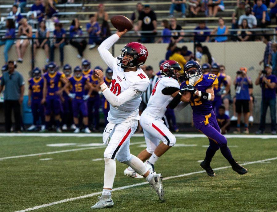 The+team+quarterback+makes+a+throw+down+the+field.