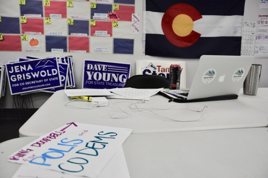 Signs%2C+paperwork+and+flags+clutter+a+table+at+the+Polis+Campaign+office.+Many+interns+are+given+the+responsibility+of+getting+out+information+on+the+Polis+Campaign.