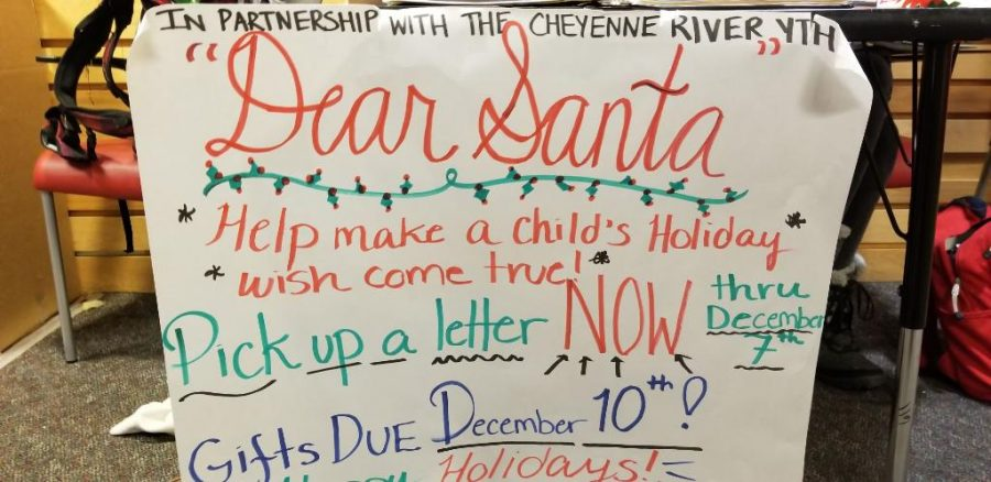 The+sign+for+the+Dear+Santa+fundraiser.+Students+and+staff+donate+gifts+to+children+who+cannot+afford+their+own.