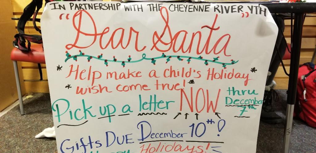 The sign for the Dear Santa fundraiser. Students and staff donate gifts to children who cannot afford their own.