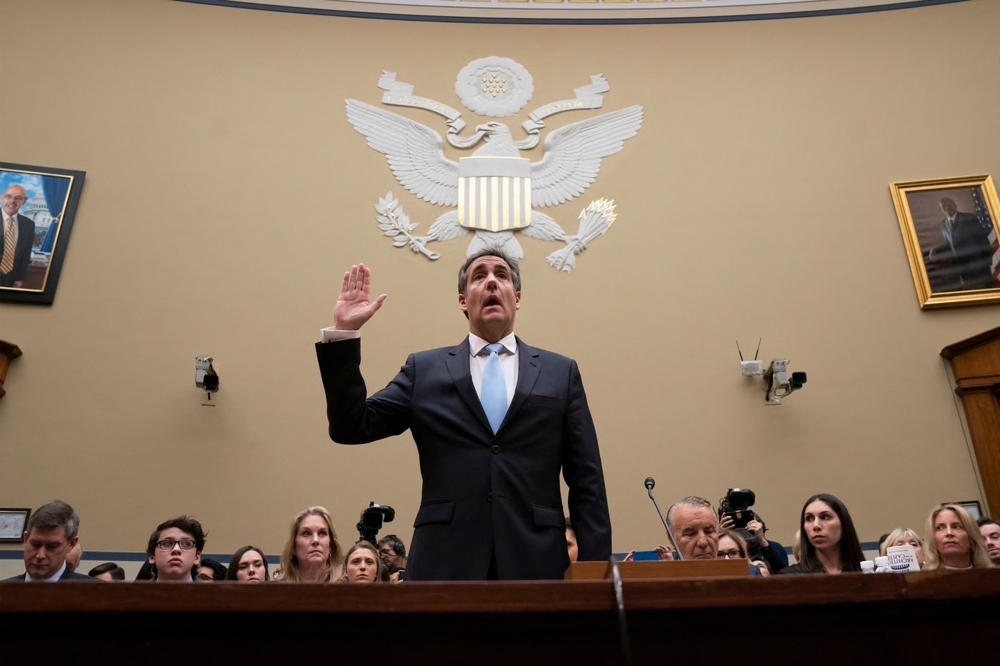 Michael Cohen stands before the House of Representatives to deliver testimony.