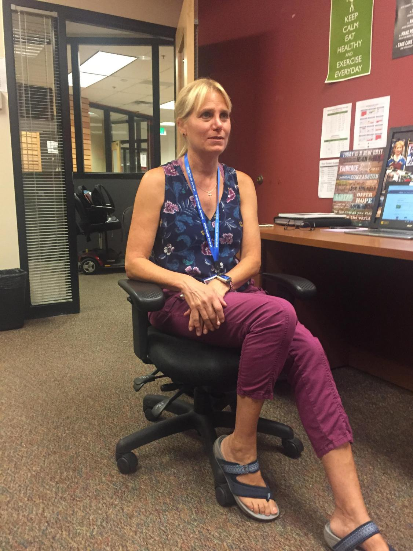 School nurse Kim Kennedy at her desk near the Senior Lounge.