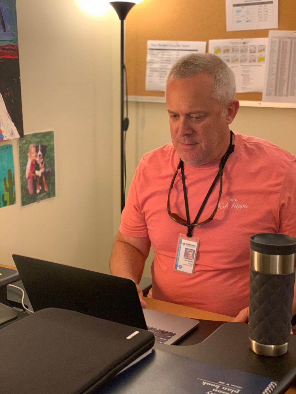 Jim Hensley working at his desk.