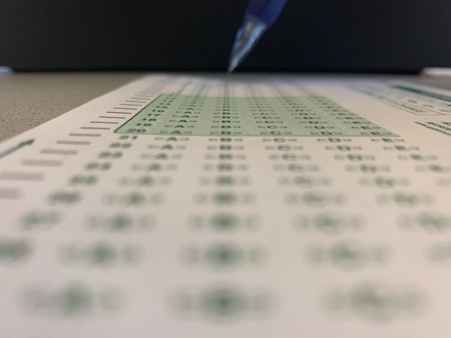 Pencil poised to take a test. Scantrons like these are used by students across the school to take exams.