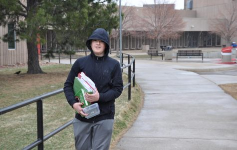 Sophomore Jasper Bloom carries his school supplies from Fairview early on Friday morning.