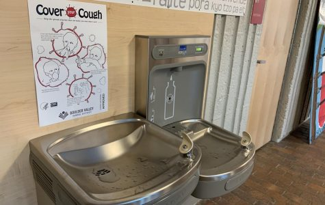 Water fountains are now decorated with more signs encouraging basic hygiene. This one shows how to cover a cough.