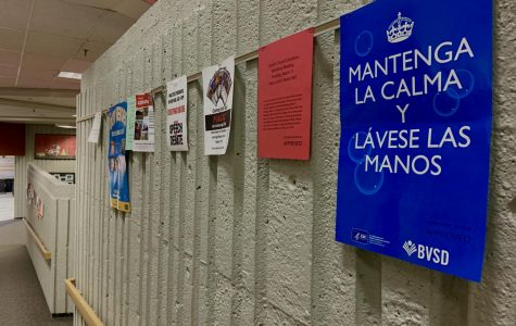 Posters adorn the walls of Fairview, promoting basic hygiene measures for students in both English and Spanish.