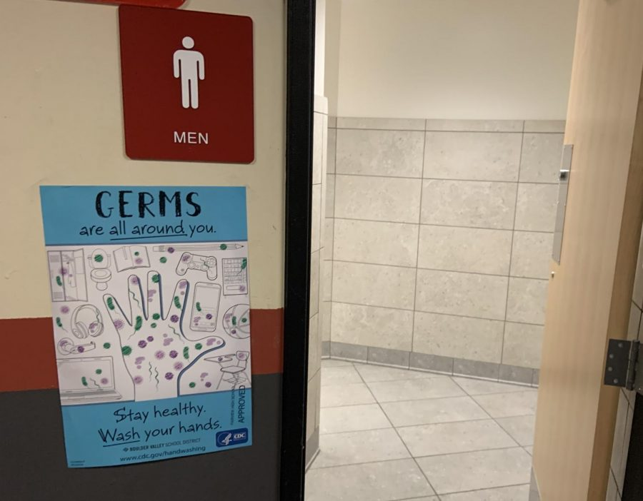 A poster showing the range of places students can find extraneous germs. It's posted outside the men's bathroom in the 600 hall.
