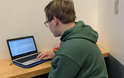 Mark Reamon researching for Physics Club.