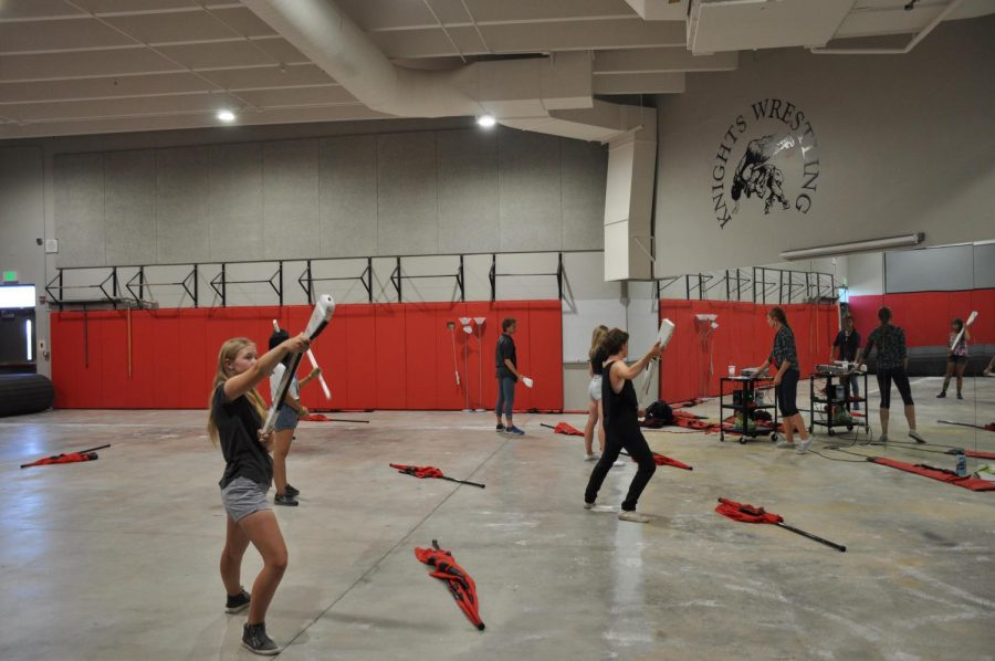 Fairview's Color Guard practices their routine. The color guard, despite controversy, has continued to perform and practice since 2018.
