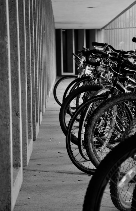 Student-owned bikes sit outside the bricks. A recent proposal has given administration incentive to give P.E. credits to riders.
