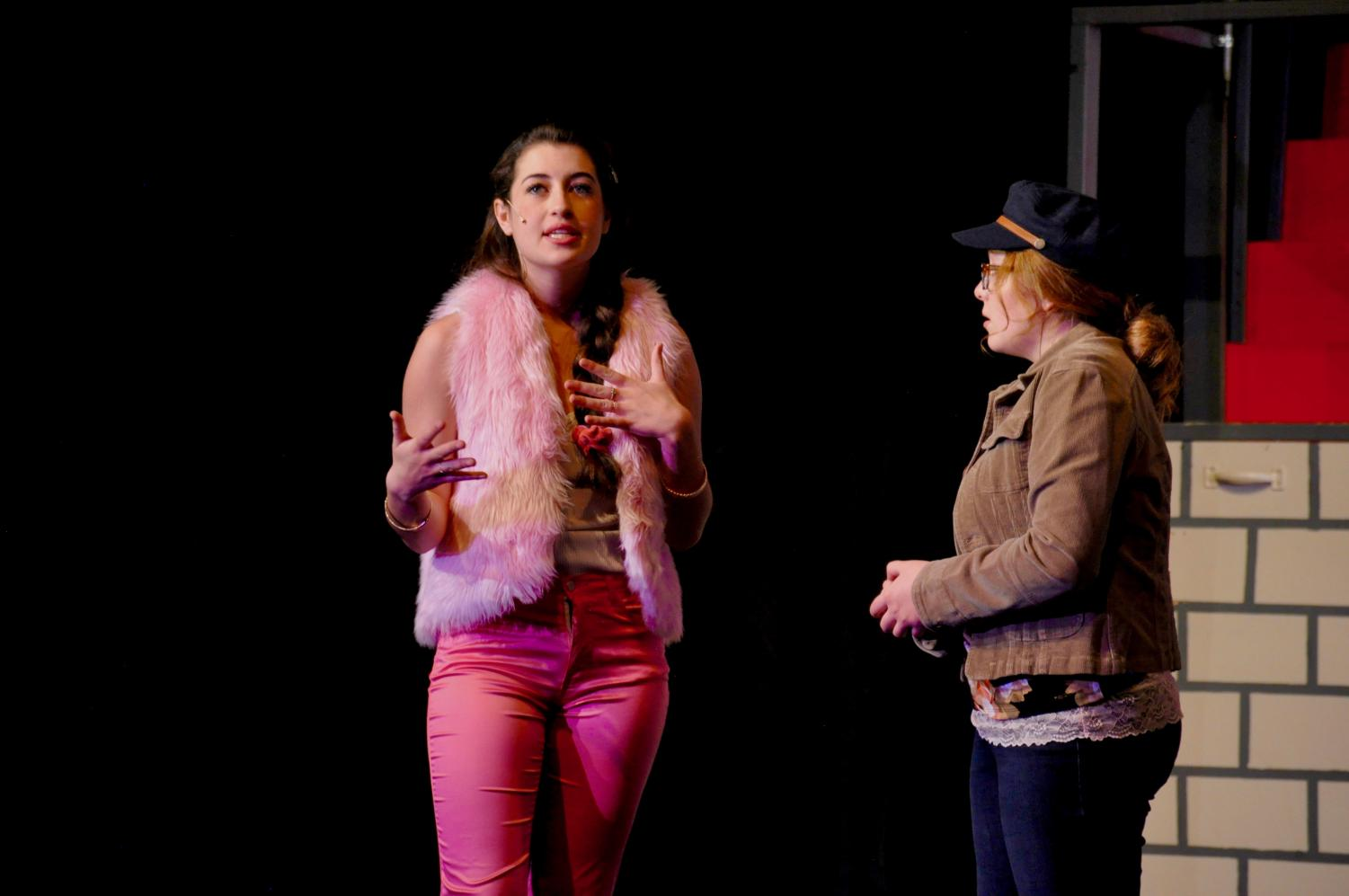 Senior Mia Parnaby, who plays Sharpay Evans, talks with fellow actress Kendall Baldwin.
