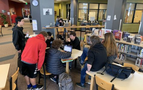 Students hard at work on their science fair projects.