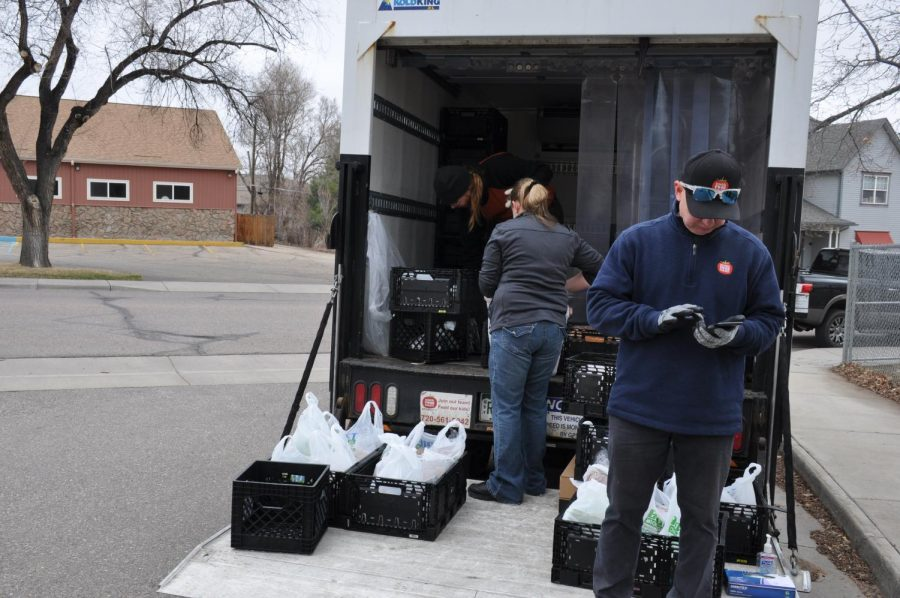 The distribution truck at Louisville Middle School, loaded with bags of food.