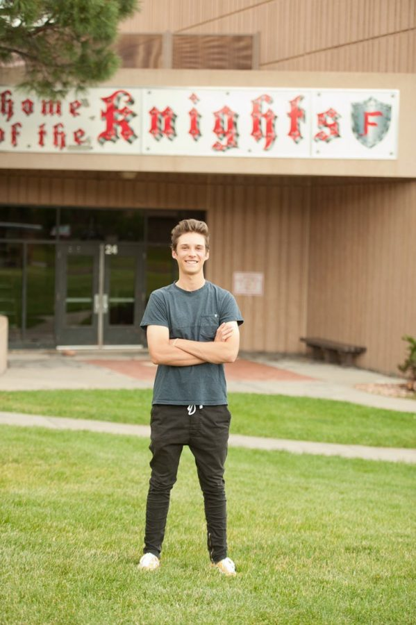 Ryder Heuston poses standing in front of Fairview High School